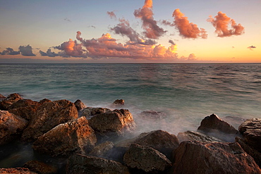 Rocky beach shoreline during sunset at Key West, Florida, USA