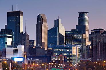 USA, Minnesota, Minneapolis, city skyline from interstate highway I-35W, dawn