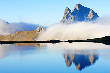 reflections in the mountain lakes of Anayet at sunset on the South slope of the peak Midi Ossau, 2884 meters, Ossau Valley, Pyrenees, France