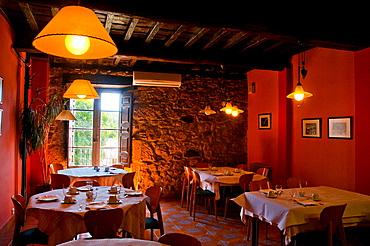 Set tables for breakfast in a rural hotel. Candelario, Salamanca province, Castilla Leon, Spain.