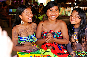 Esilda on left and her friends, young teenagers of Embera native community living by the Chagres River within the Chagres National Park, Republic of Panama, Central America