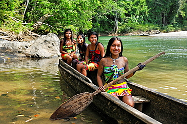 Esilda and her friends on pirogue, young teenagers of Embera native community living by the Chagres River within the Chagres National Park, Republic of Panama, Central America