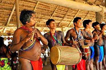 men playing music in a village of Embera native community living by the Chagres River within the Chagres National Park, Republic of Panama, Central America