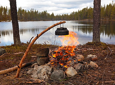Coffee pan on a fire at a lake in Jokkmokk in Swedish lapland