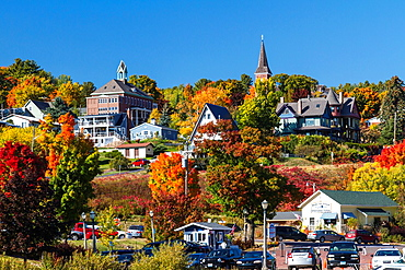 Homes on the hillside with fall foliage color overlooking Bayfield, Wisconsin, USA