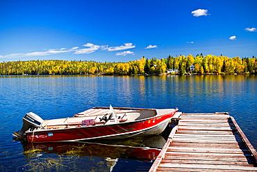 A northern Manitoba landscape of fall foliage color and reflections in a small lake near Flin Flon, Manitoba, Canada