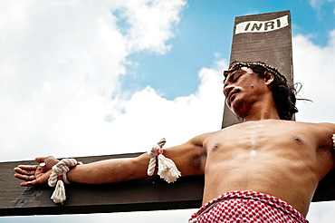 Rolly Bautista Pantoja being crucified on Good Friday, San Fernando, Pampanga, Philippines