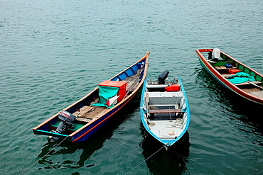 Three floating boats, asia