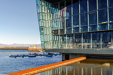 Harpa Concert Hall and Conference centre building designed by Hennin Larsen and Batterii Architects It is placed at Reykjavik harbour Iceland
