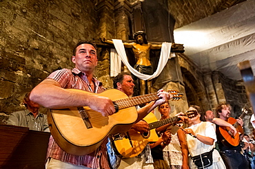 Europe, France, Bouche-du-Rhone, 13, Saintes-Marie-de-la-Mer, pilgrimage of gypsies, gypsies playing guitar in a church