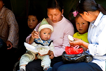 Mother Feeding Child, Xingping, Guangxi Province, China