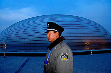 Security policeman at the The National Theatre in the night, Beijing, China, Asia
