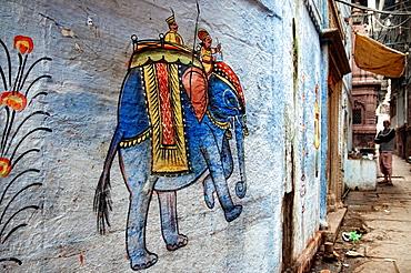 Painted wall in an alley in the old town Varanasi, Benares, Uttar Pradesh, India