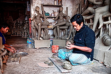 Men making effigies of gods in a workshop in Kumartuli district, Calcutta, West Bengal, India