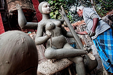 Man making effigies of gods in a workshop in Kumartuli district, Calcutta, West Bengal, India