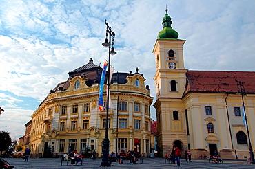 City Hall, left, baroque Jesuit Church, right, Main Square, Sibiu, Transylvania, Romania, Europe