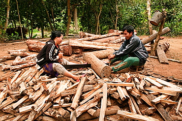 ethnic Khmu couple enjoying cutting wood, Luang Nam Tha, Laos