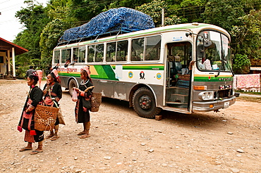 Akha women greeting a long distance bus enroute to Phongsaly, Laos
