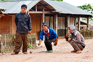 Akha boys playing petanque, Phongsaly, Laos