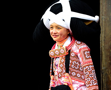 Portrait of a Long Horn Miao girl taken at her home in Long Ga village