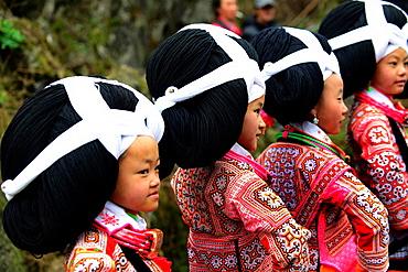 Long Horn Miao teenage girls dancing during the annual Tiao Hua festival in western Guizhou