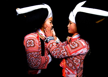 Long Horn Miao teenage girls put makeup on each other as preparation for the Tiao Hua festival