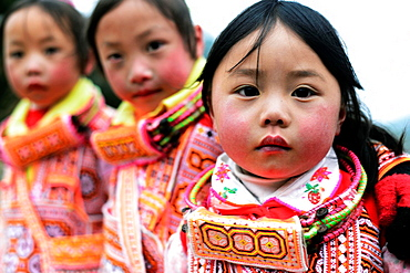 Long Horn Miao girls dancing in the annual Tiao Hua festival in western Guizhou, China