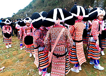 Long Horn Miao teenage girls dancing in the annual Tiao Hua festival in western Guizhou, China