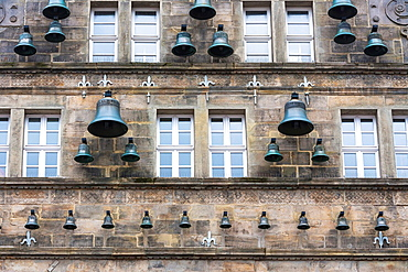 Close up of the bells of the historic Hochzeitshaus in Hamelin on the German Fairy Tale Route, Lower Saxony, Germany, Europe