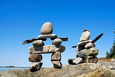 cairns, Pointe aux Epinettes, Bic National Park, Quebec province, Canada, North America
