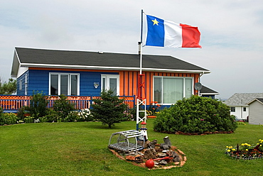 house sporting the flag of Acadia, Cap aux Meules island, Magdalen Islands, Gulf of Saint Lawrence, Quebec province, Canada, North America