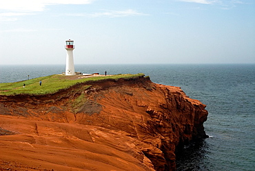 lighthouse on the sandstone cliffs of Etang-du-Nord cape, Cap aux Meules island, Magdalen Islands, Gulf of Saint Lawrence, Quebec province, Canada, North America