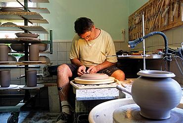 Serge Comazzi in his workshop, Poterie de la Forge, Abreschuiller, Moselle department, Lorraine region, France, Europe