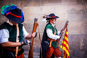 `Trabucaires' men armed with blunderbuss at Bisbe street during La Merce Festival Barcelona Catalonia Spain