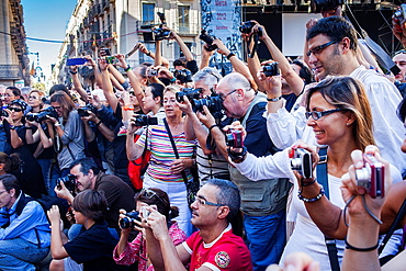 people taking pictures of `Trabucaires' during La Merce Festival Placa de Sant Jaume Barcelona Catalonia Spain