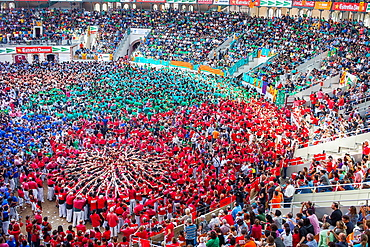 Colla Joves Xiquets de Valls starting a tower 'Castellers' building human tower, a Catalan tradition Biannual contest bullring Tarragona, Spain