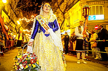 Flower offering,People with Floral tributes to `Virgen de los desamparados', Fallas festival,San Vicente Martir street,Valencia,Spain