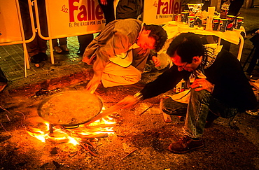Men cooking paella,Convento Jerusalen street,Fallas festival,Valencia,Spain