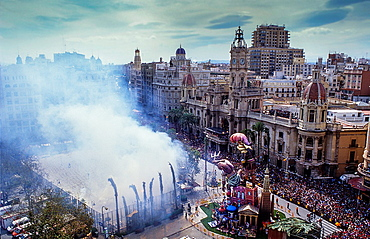 `Mascleta' firecrackers and falla in Plaza del Ayuntamiento,Fallas festival,Valencia,Spain