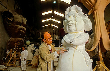 Workers making a falla in workshop of Manolo Martin,Ciudad del artista fallero Fallero city artist,Valencia,Spain