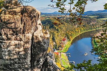 View from the spectacular rock formation Bastei Bastion to health resort Rathen near Dresden and the Elbe River. The Bastei is one of the most visited tourist attractions in the national park Saxon Switzerland, municipality Lohmen, Saxony, Germany, Europe