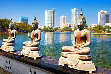 Sri Lanka, Capital City Colombo, Buddha Statues in Seema Malaka Temple on Beira Lake, 'World Trade Center' in the background , Sri Lanka, Asia