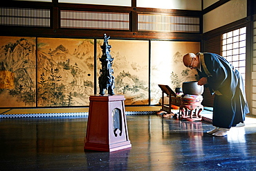 A high priest performs traditional rituals at the Zuiho-in, a sub-temple of the Daitokuji Monastery in Kyoto Japan