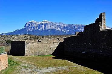 Pena Montanesa stands behind Ainsa Castle, in Sobrarbe Pyrenean region. Huesca, Spain.