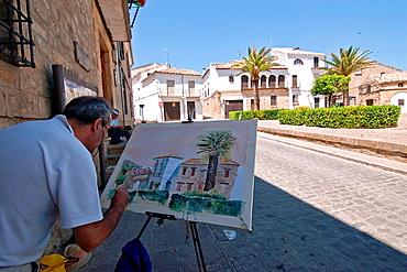 Painter paint a square of Sabiote, Jaen, Spain
