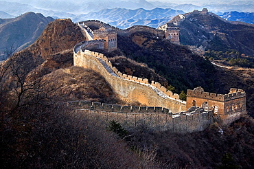 The Great Wall of China snaking across the hills. China, Beijing, Jinshanling, Great Wall