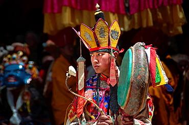 Buddhist festival at the Hemis Gompa, monk with large-pan drum. India, Jammu and Kashmir, Ladakh, Hemis