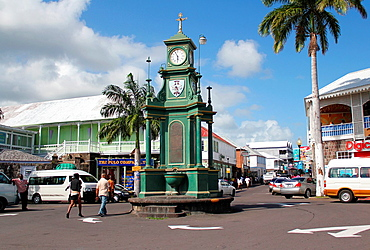 An old ornate clock in the featured attraction in the center of the Independence Square roundabout in the city of Basseterre on the Caribbean island of St Kitts