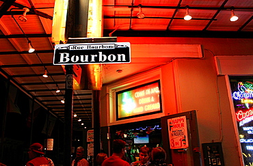 Colorful night shot of a street sign along Bourbon Street, New Orleans, Louisiana