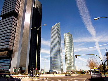 Jet Trails in sky over skyscrapers in North Madrid